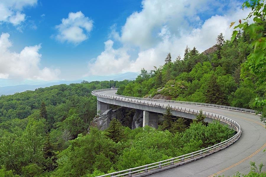 Linn Cove Viaduct during the summer. The Linn Cove Viaduct is located on the Blue Ridge Parkway close to Grandfather Mountain.