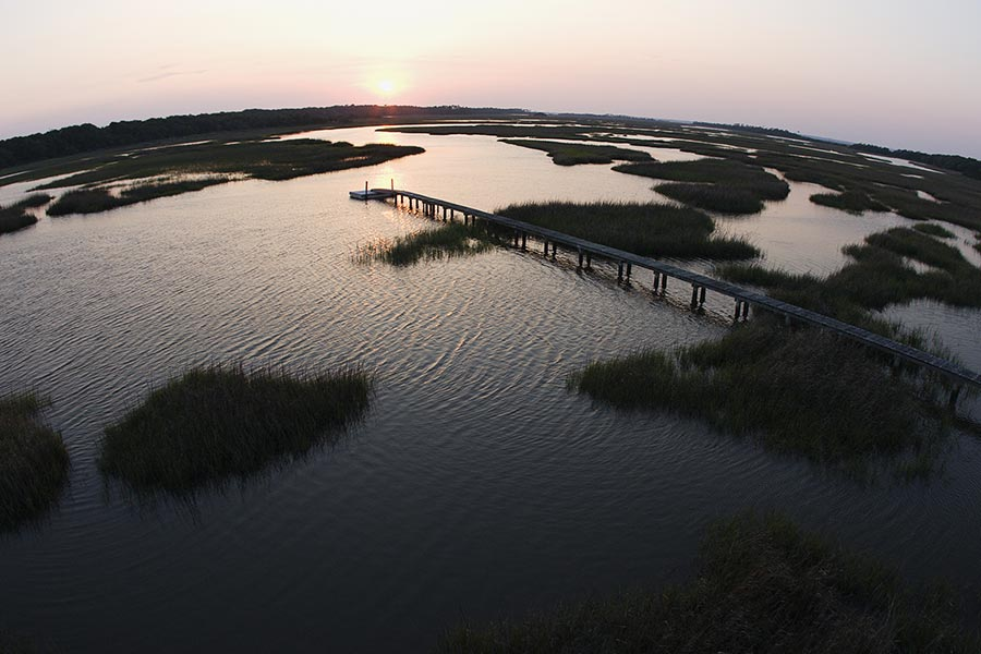 A really cool aerial shot of Bald Head Island at dawn.